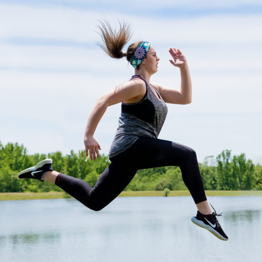 fitness portrait young woman jumping in the air